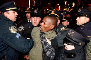 Police arrest protester in midtown NYC after grand jury decision not to indict over death of Eric Garner. (AP photo)